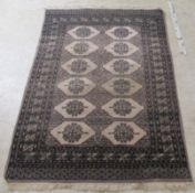 A Bokhara rug, decorated with two columns of six hexagonal guls,