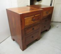A pair of modern Indonesian teak three drawer bedside chests, raised on block feet 28''h 19.