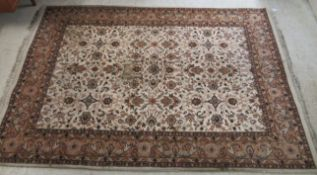 A Persian rug, decorated with floral designs,