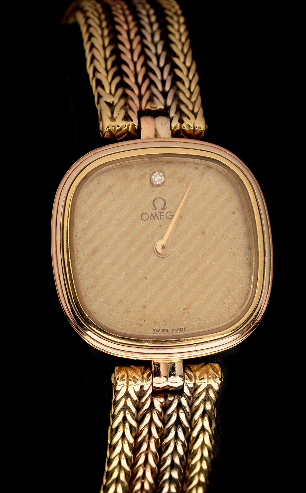 Lot 5 - Omega 18ct gold cocktail watch