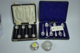Two spoon sets and two pots