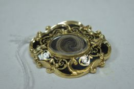 A 19th Century black enamel brooch