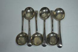 Set of six silver dessert spoons