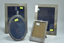 Four silver framed picture frames