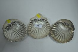Three silver shell pattern dishes