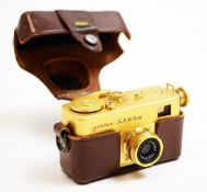 A Riken Golden Steky subminiature camera; and Riken Steinar lens, cased.