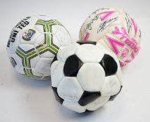 Two signed Newcastle United footballs; and a Welsh Football Team signed football.