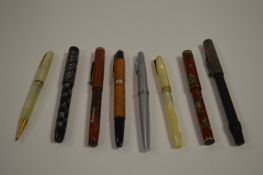 Eight assorted pens