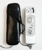 A Minox Wetzlar miniature camera; Complan lens, leather case.