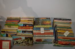 Paperback books including Super Heroes and Sci-Fi novels.