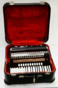 A Hohner Atlantic IVN Musette 120 bass piano accordion.
