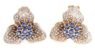 A pair of leaf pattern sapphire and diamond earrings