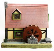 A 20th Century scratch-built doll's mill house.