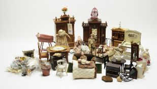 A collection of antique and vintage dolls, furniture and other items.
