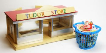 """A doll's mid 20th Century British shop """"Tudor Store"""", and miniature groceries."""