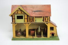 D.H. Wagner & Sohn, Grunaichen, Germany: toy stables with a hayloft, and other items.