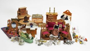 A collection of doll's house dolls, furniture and other items.