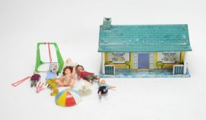 A collection of antique and vintage doll's bungalow, dolls and furnishings.
