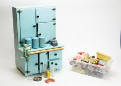 Tri-ang, England: a doll's blue-painted wood kitchen dresser, and accessories.
