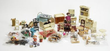 A collection of vintage and antique miniature dolls, furniture and other items.