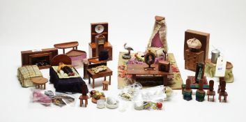 A collection of vintage doll's house furniture.