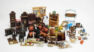 A collection of antique and vintage miniature dolls, furniture and other items.