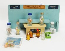 """A mid 20th Century British painted wood """"Little Folks"""" doll's shop, and accessories."""
