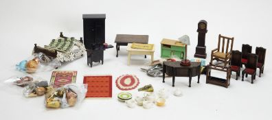 A collection of miniature dolls, furniture and other items.