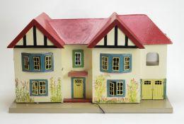 Tri-ang, England: a 1950's double-bay suburban house and garage.
