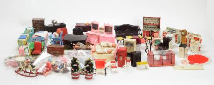 A collection of miniature dolls, doll's furniture, and other items.