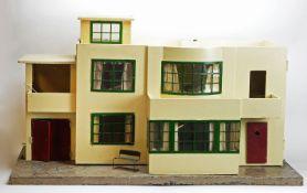 Tri-ang, England: a Model No. 53 modern doll's house,