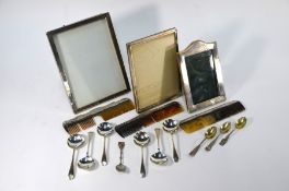 Three silver-faced photograph frames etc