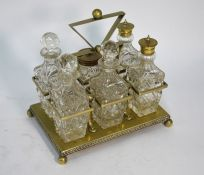 A conical cut glass decanter with silver collar and other items