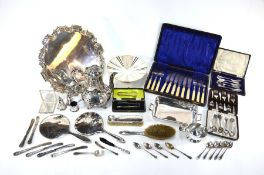 A silver brush set, flatware and other items