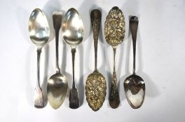 A pair of late Victorian silver berry spoons