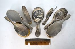 Five various silver-backed hairbrushes etc