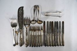 A set of eight Victorian silver dessert knives and six forks