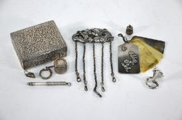 A Chinese white metal chatelaine with finely-worked dragon-and-pearl brooch