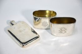 Silver hip flask and two beakers