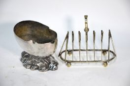 A cricket design toastrack and a spoon warmer