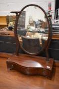 A 19th century mahogany oval toilet mirror