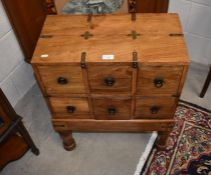 A small Indonesian hardwood brass bound chest on stand