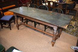An antique provincial pine dining table and chairs