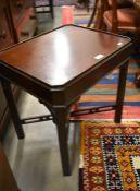 A small mahogany side table