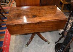 A Regency period mahogany drop leaf table