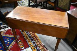 A late Victorian mahogany pembroke table