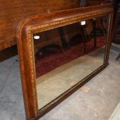An Edwardian overmantle mirror