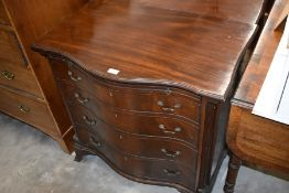 A Georgian style mahogany serpentine-front chest