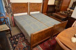 A pair of Edwardian burr walnut single beds