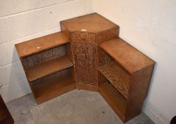 A Heal's style limed oak corner bookcase